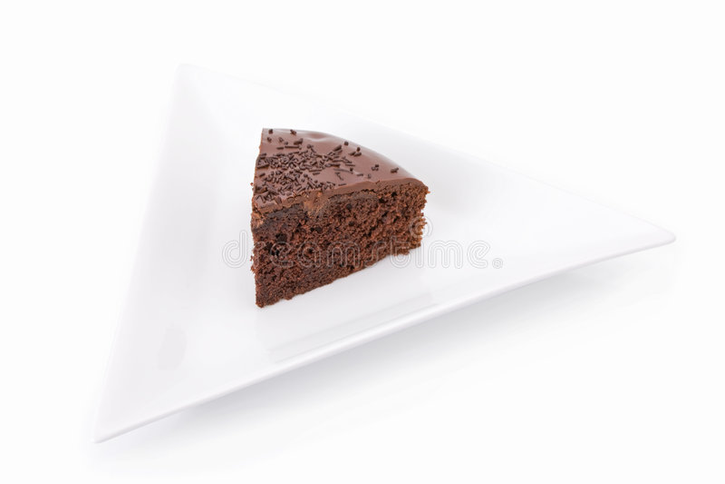 Slice of chocolate fudge cake stock photography