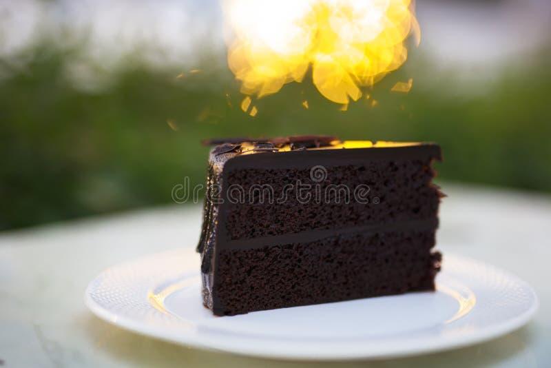 Slice of chocolate fudge cake stock photos