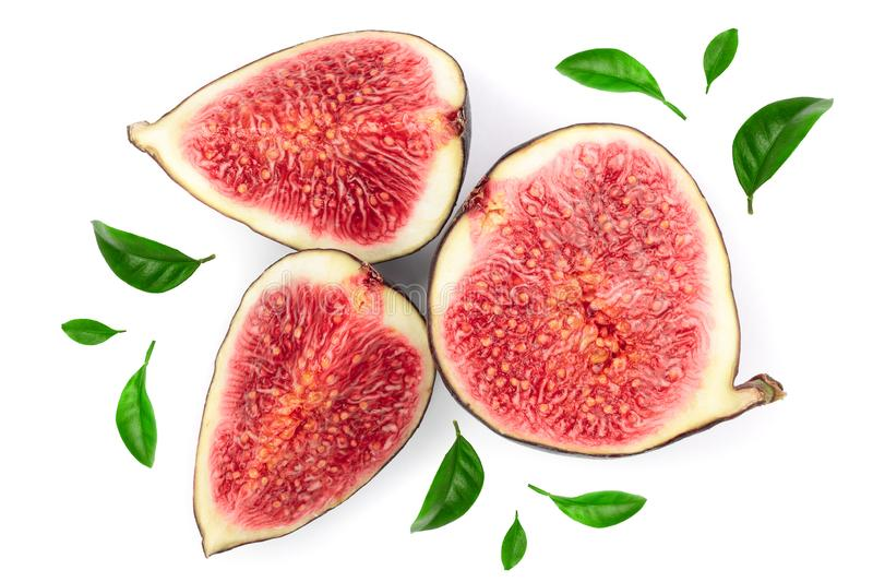 Slice fig fruits with leaves isolated on white background. Top view. Flat lay pattern stock images