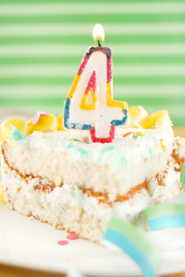 Slice of fourth birthday cake stock photos