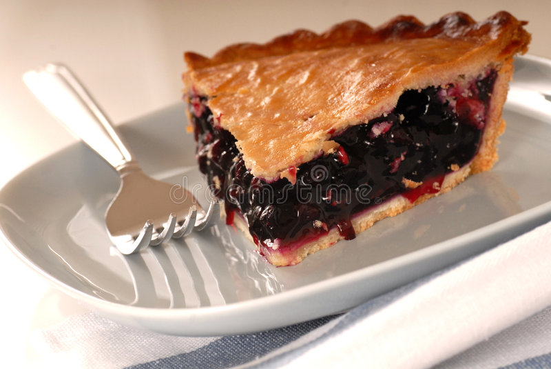 Slice of fresh blueberry pie on a plate royalty free stock photos