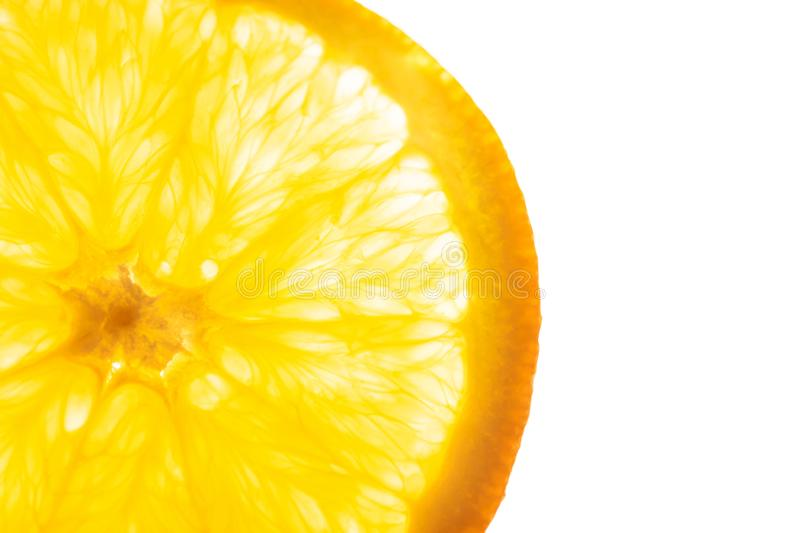 Slice of fresh juicy translucent orange with seeds flesh texture backlit on white background. Top view flat lay. Vibrant color royalty free stock images