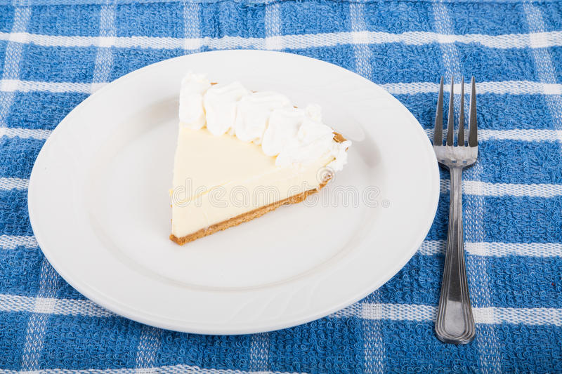 Slice of Fresh Key Lime Pie on Table stock photo