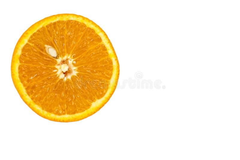 Slice of fresh orange with seed stock photography