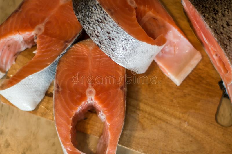 Slice of fresh salmon on cutting board stock images