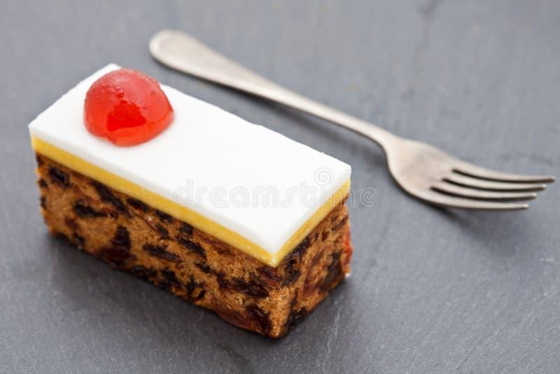 Slice of fruit Christmas cake royalty free stock photography