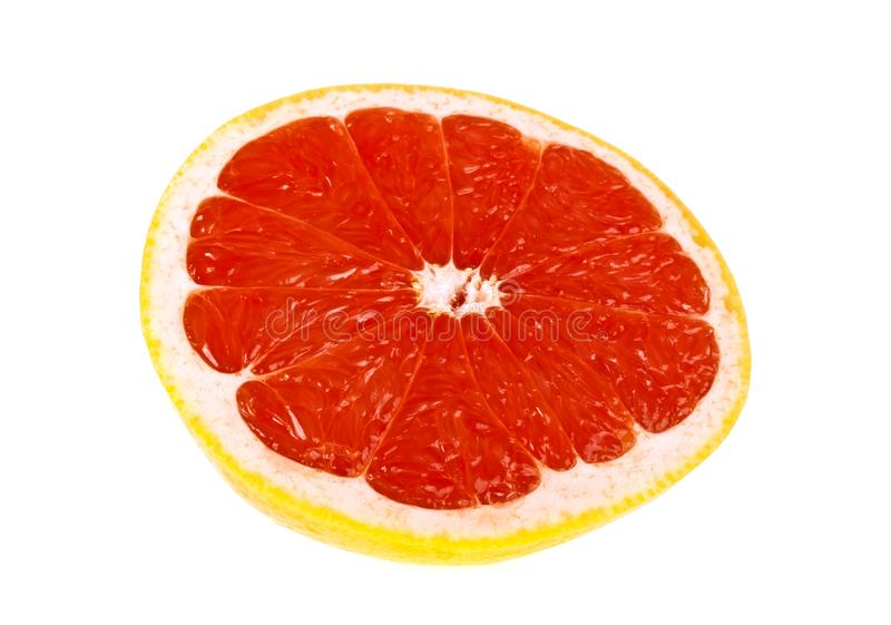 Slice of grapefruit isolated on white background. Front view royalty free stock photos