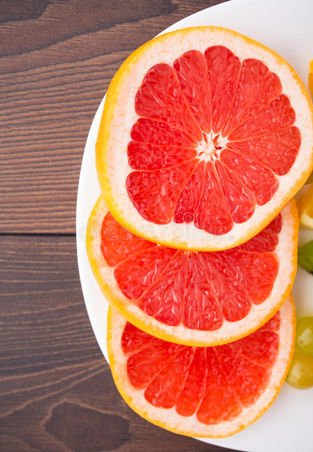 Download Slice Of Grapefruit On A Palte Stock Photo - Image: 33575032