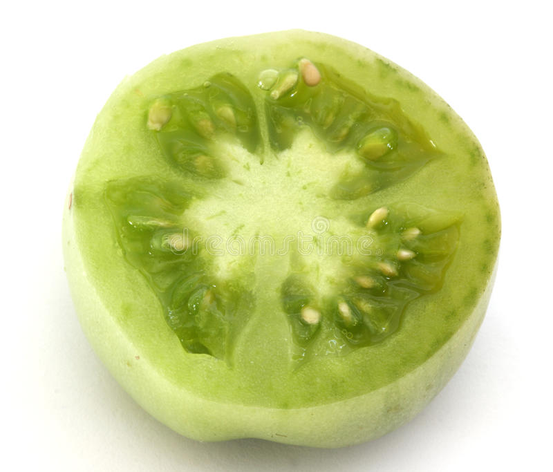 Slice of green tomatoe royalty free stock photography