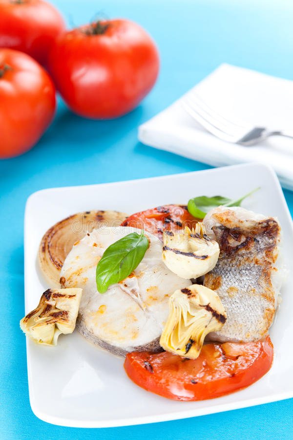Slice of hake grilled stock photography