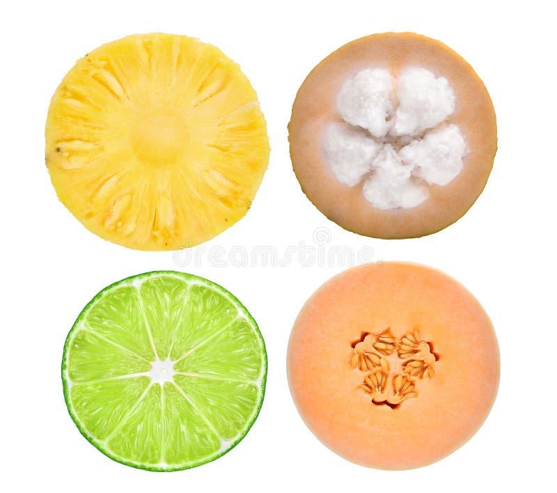 Slice half cut of pineapple,santol,lime,honeydew melon isolated royalty free stock photo