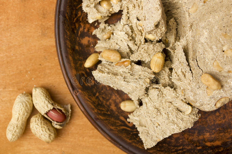 Slice of halva with peanuts stock images
