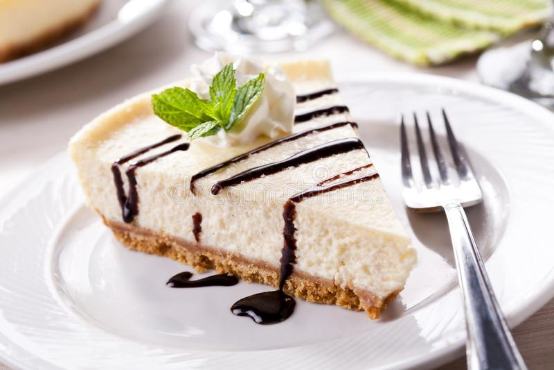 Slice Of Homemade Vanilla Cheesecake With Chocolate stock photography