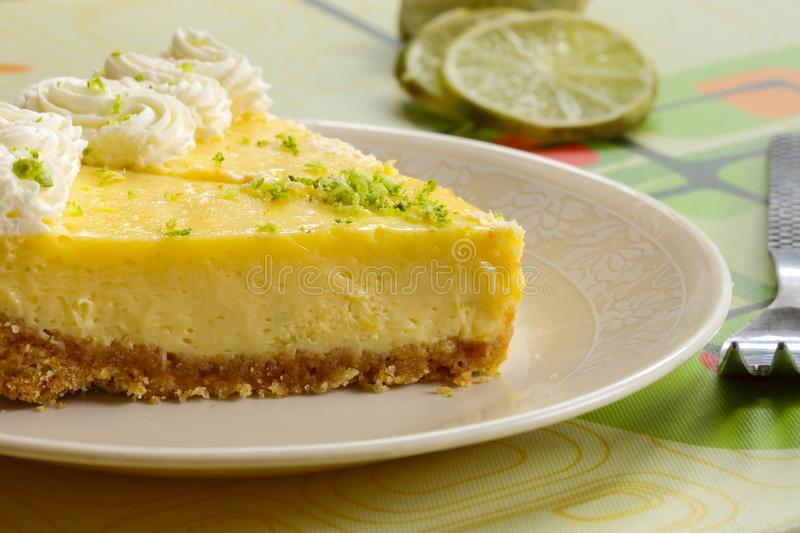 Slice of key lime pie dessert American food stock photos