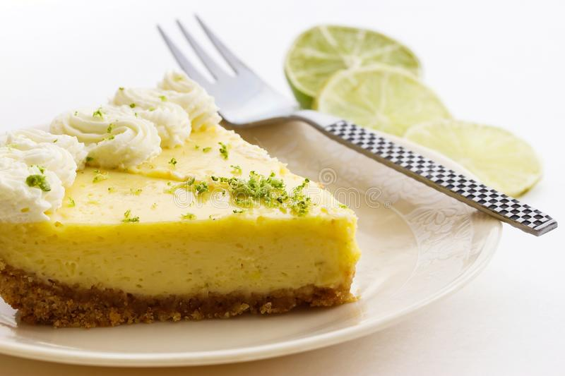 Slice of a key lime pie stock photo