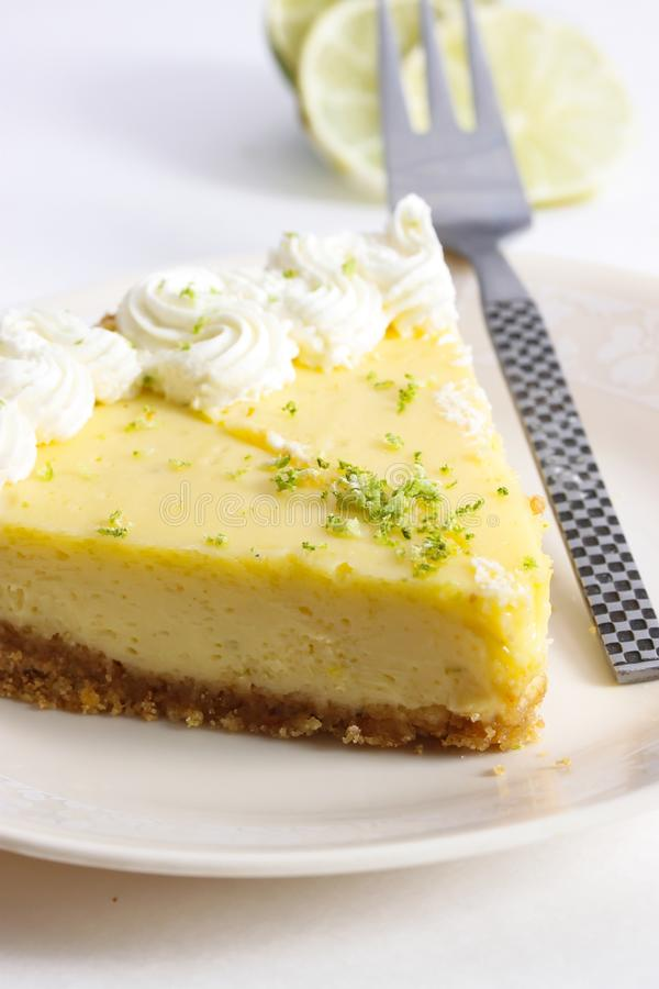 Slice of a key lime pie stock photography
