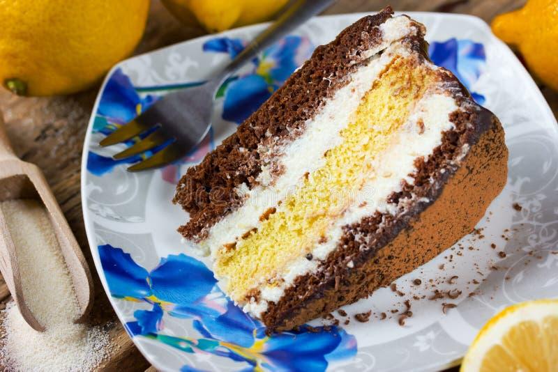 Slice of layer cake , chocolate lemon semolina cake. For a holiday party stock photo