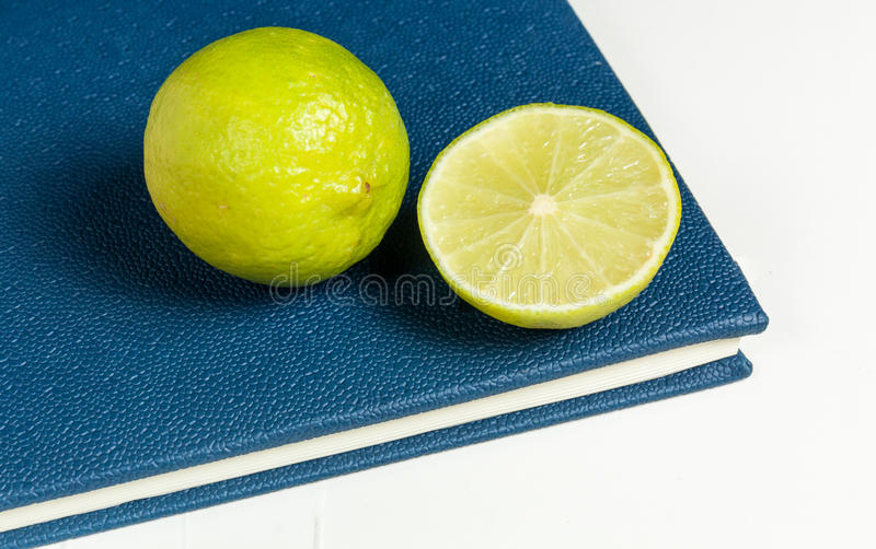 Slice of lemon on blue diary. Of year 2016 royalty free stock photography