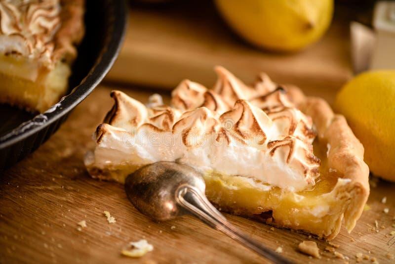 Slice of lemon meringue tart royalty free stock photography