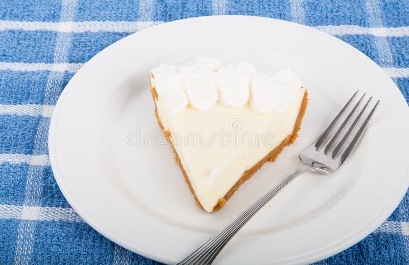 Slice of Lemon Pie on Plate stock photography