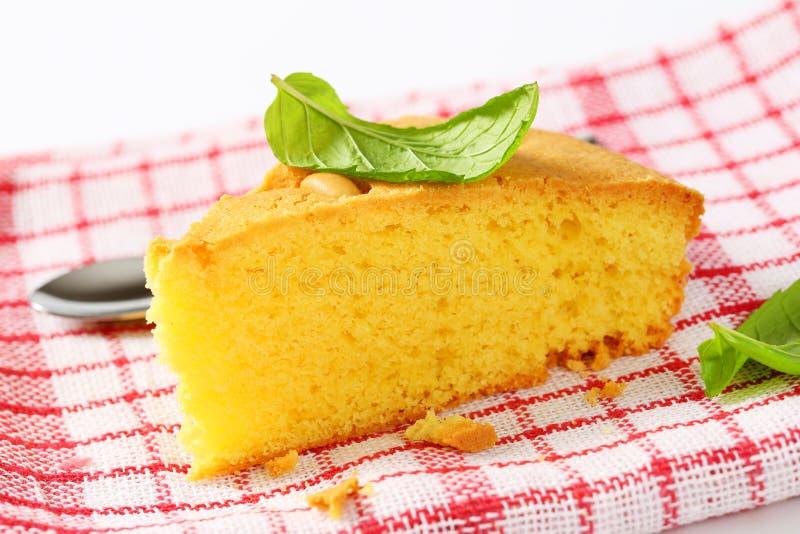 Slice of lemon sponge cake royalty free stock image