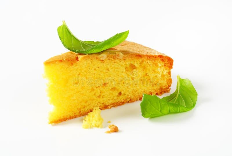 Slice of lemon sponge cake stock images