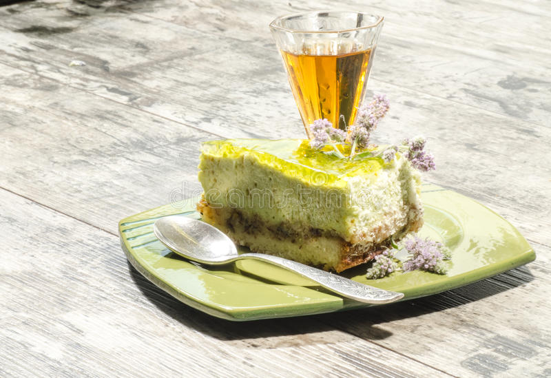 Download Slice Of Lime Cheesecake Decorated With Mint Flowers And Glass Of Cognac Royalty Free Stock Photo - Image: 34634765