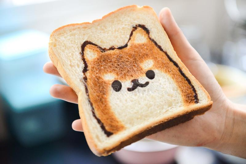 Slice of Loaf Bread With Dog Face stock photos