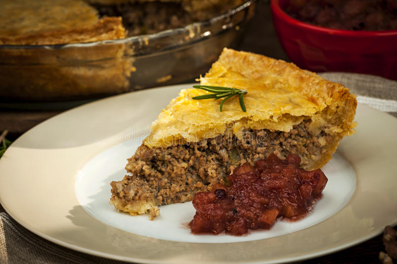 Slice of meat pie Tourtiere stock photos