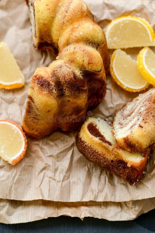 Bundt marble cake, and lemon slices royalty free stock photos