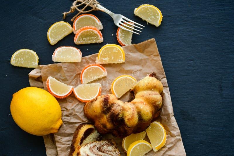 Bundt marble cake, and lemon slices stock image