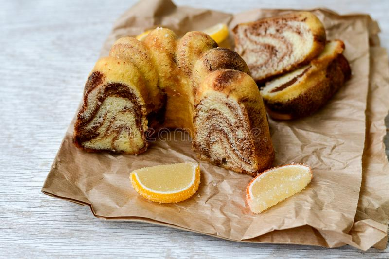 Bundt marble cake, and lemon slices stock image