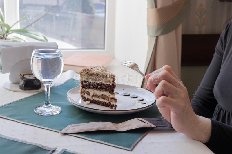 A slice of multi-layered nut cake in a cafe stock images