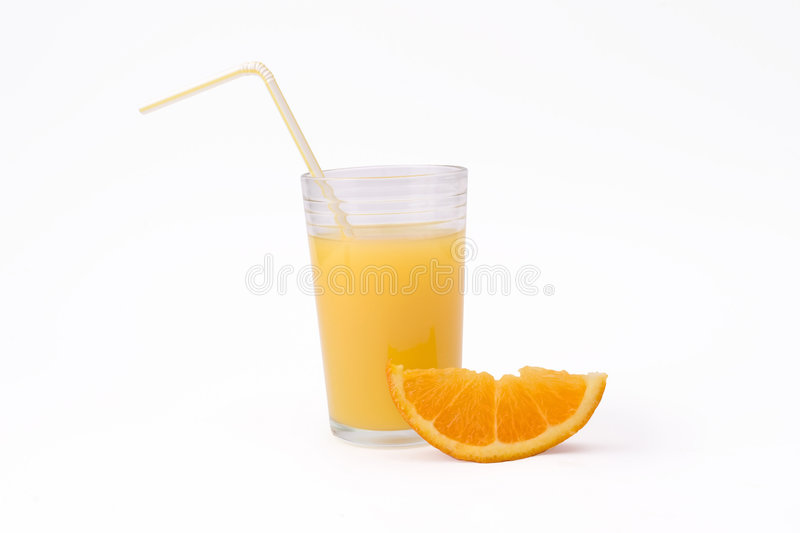Slice of orange and glass of orange juice with straw stock image