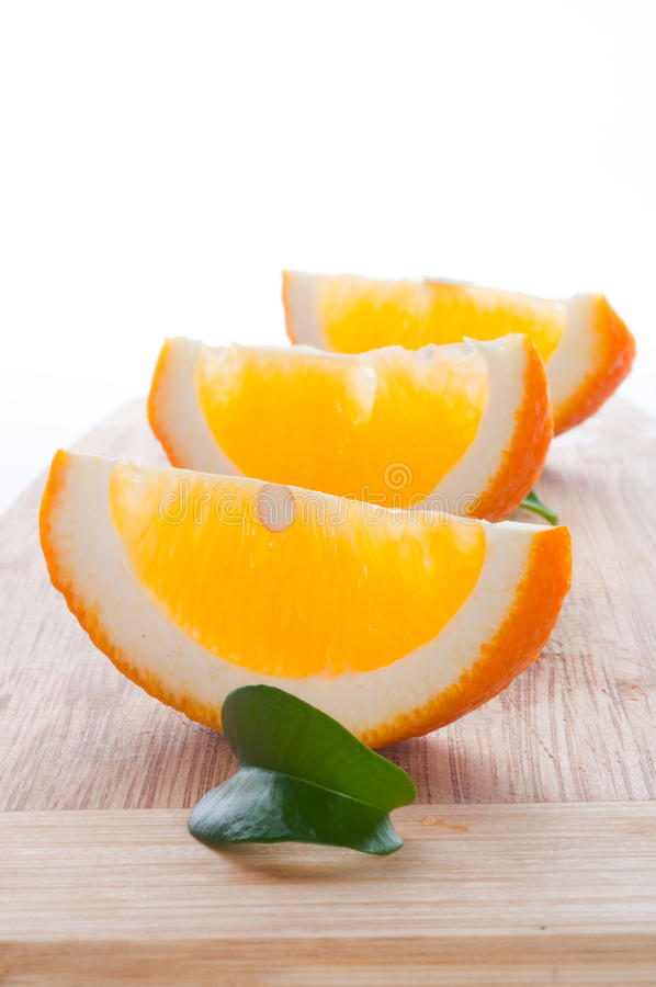 Slice of orange and leaf royalty free stock image