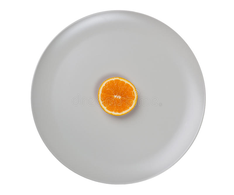 Slice Of Orange On A Plate Royalty Free Stock Image