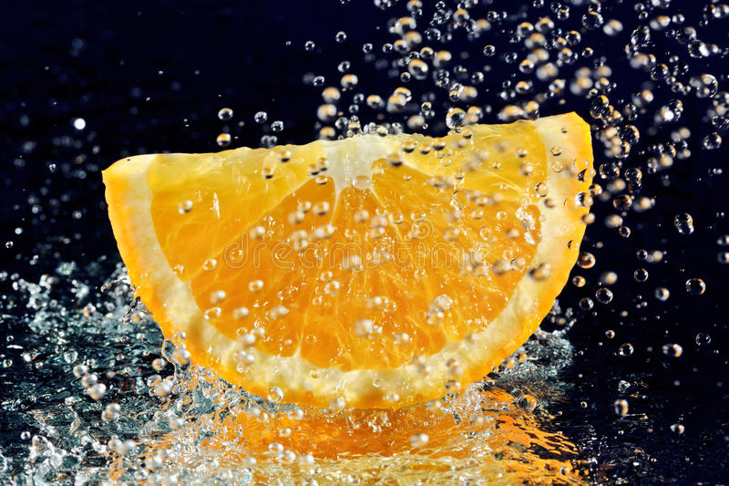 Slice Of Orange With Stopped Motion Water Drops Stock Image