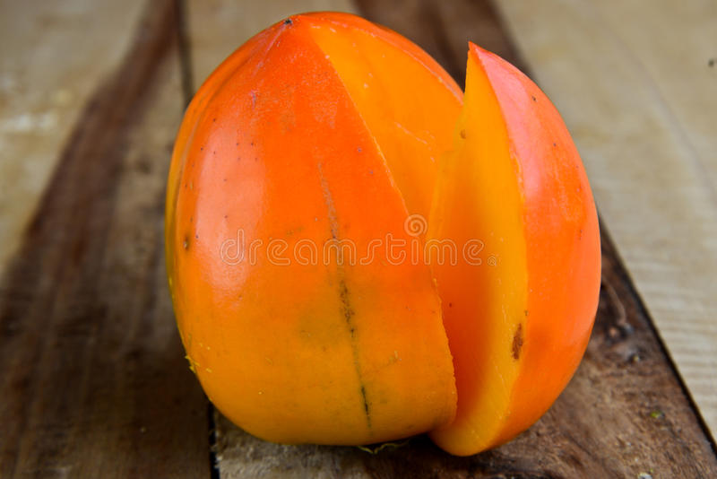Slice Persimmon and Persimmon stock photography