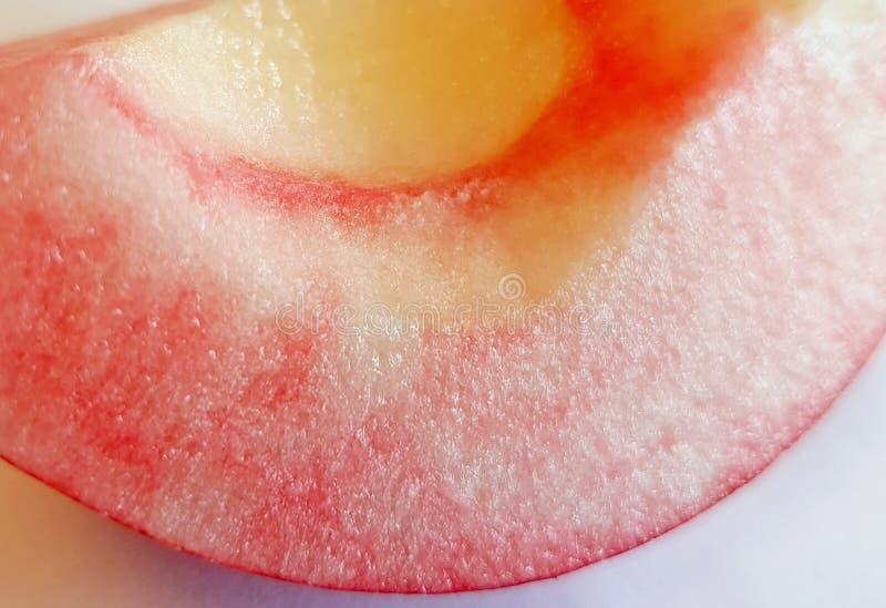 A slice of pink crispy juicy apple fruit stock images