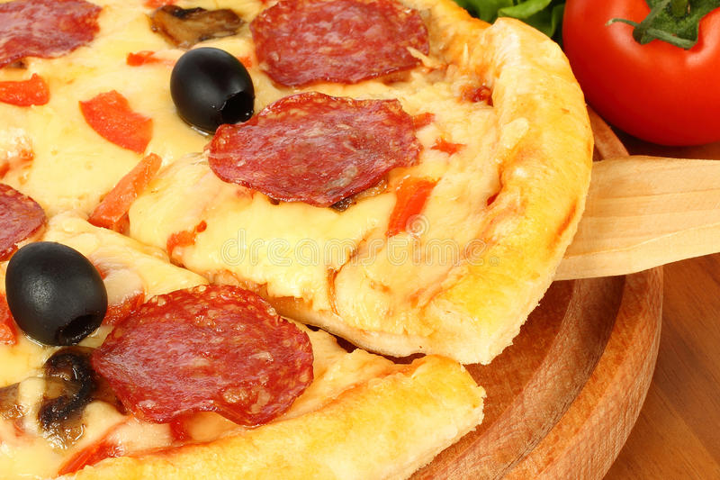 A slice of pizza royalty free stock photo