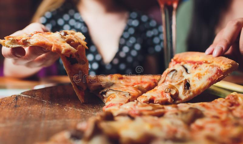 Slice of pizza cheese crust seafood topping sauce. with bell pepper vegetables delicious tasty fast food italian royalty free stock images