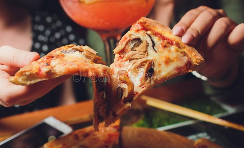 Slice of pizza cheese crust seafood topping sauce. with bell pepper vegetables delicious tasty fast food italian royalty free stock photos