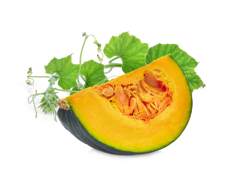 Slice of pumpkin with green leaf on white stock photo