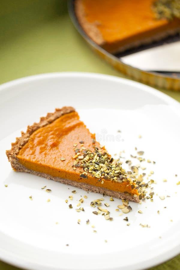 Slice of pumpkin pie stock images
