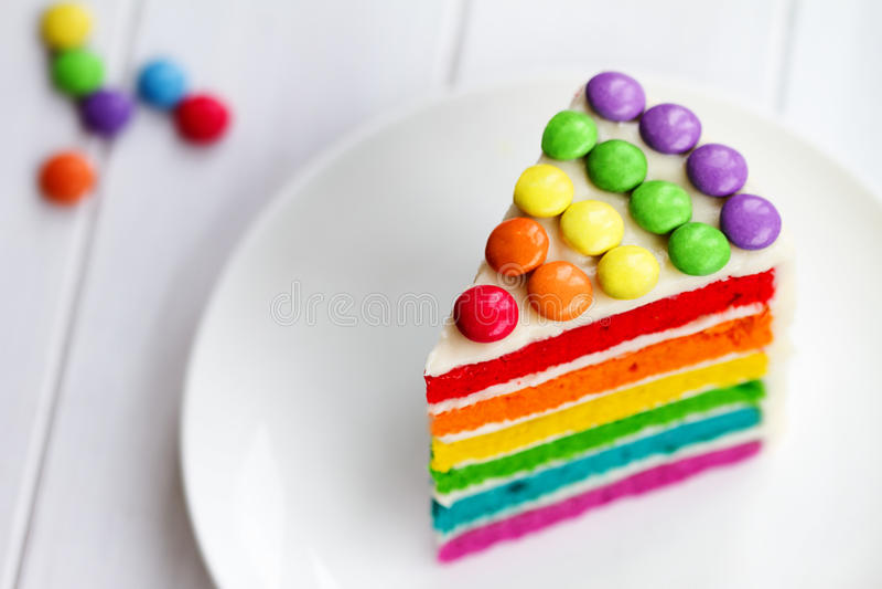 Slice of rainbow cake royalty free stock photo