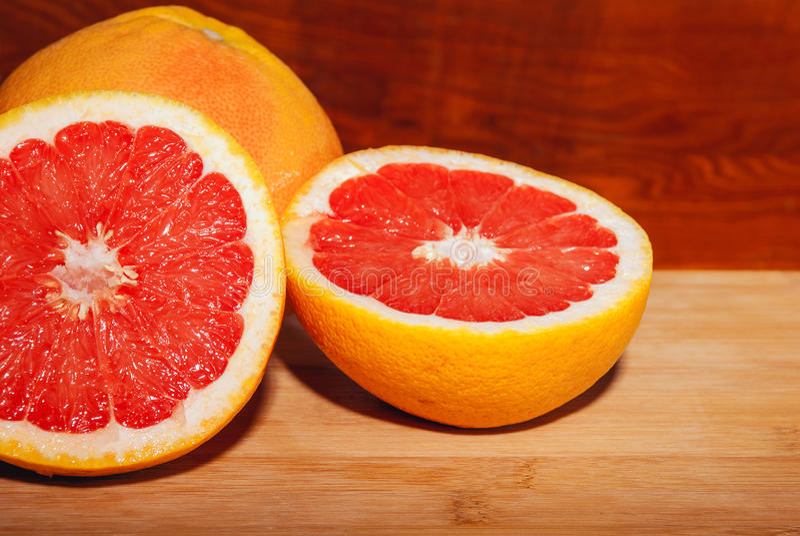 Slice red grapefruit stock image
