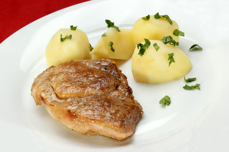 Slice Of Roast Pork With Boiled Potatoes Royalty Free Stock Photo