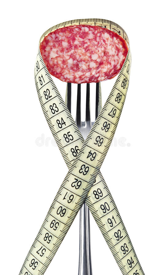 Slice of sausage on a fork stock photos