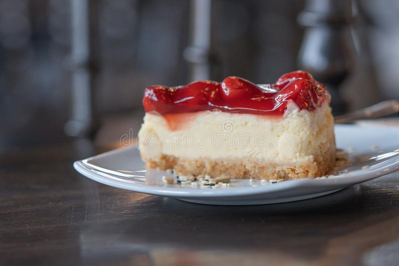 Slice Strawberry cheesecake layer cake Dessert Food on a white plate in the cafe focus blur background. Closeup Slice Strawberry cheesecake layer cake Dessert stock photos
