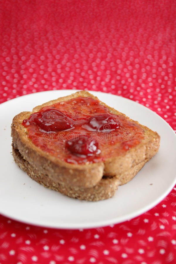 Slice with strawberry jam royalty free stock photo
